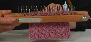 Do a criss cross stitch on a knitting board
