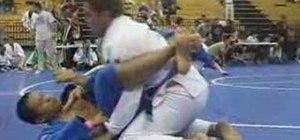Do a jiu jitsu arm trap triangle move