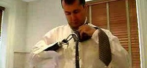 Tie a tie and dress with a prosthetic arm for amputee
