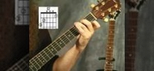 Play the G7 chord on the acoustic guitar