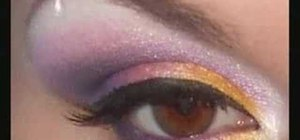 Apply pink and yellow tropical eye shadow