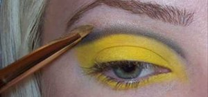 Apply yellow and black eye makeup