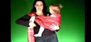 Remove a toddler out of the hip carry sling position
