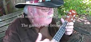 "Play ""The Gambler"" by Kenny Rodgers on the ukulele"