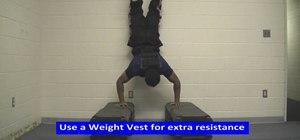 Get broader shoulders doing handstand pushups