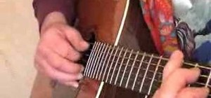 Play chords on the guitar in a Delta blues style