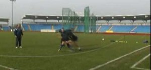 Develop foot and shoulder position in rugby tackles