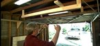 How to Use the space above a garage door with a storage rack