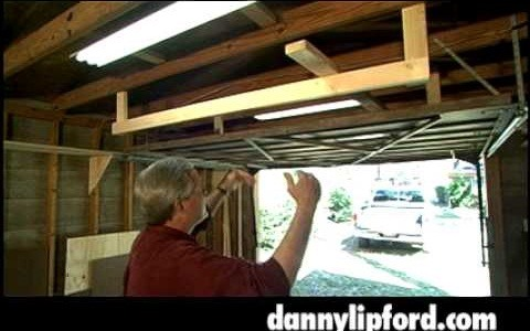 Use the space above a garage door with a storage rack