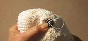 Sew a button onto a knit hat