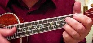 "Play the ""Let It Snow"" Christmas carol on ukulele"