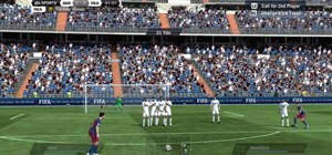 Perform a dipping free kick in FIFA 11 on the Xbox 360