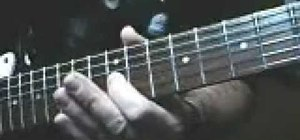 "Play ""Electric Funeral"" by Black Sabbath on guitar"