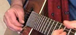 Play Delta blues-style embellishments on guitar in E
