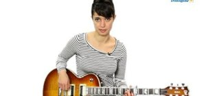 Play a C-sharp (C#) chord on an acoustic or electric guitar