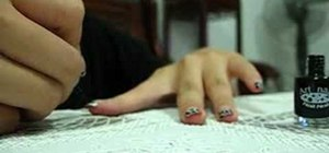 Paint a leopard print French manicure with glitter