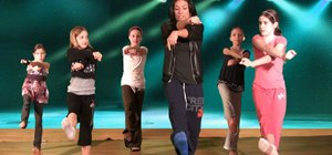 Do a body roll step in hip hop dance for kids