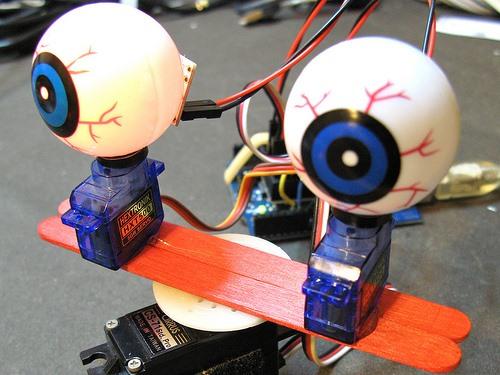Hack together creepy arduino shifty eyeballs for halloween