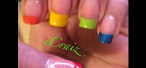 Paint a rainbow French tip nail manicure