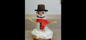Decorate an adorable snowman cupcake for Christmas