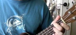 "Play the song ""One Foot on Sand"" by Justin Young on ukelele"