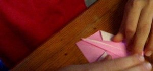 Make a swan from a sheet of folded paper with origami