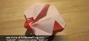 Fold an origami peacock or turkey