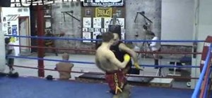 Do a Muay Thai kickboxing foot jab to leg sweep drill