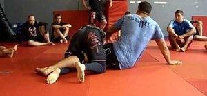 Escape a bottom pin by using an arm post technique
