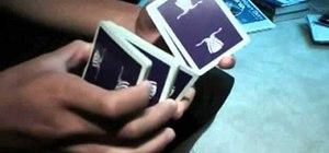 "Perform the ""Symmetry"" card flourish trick"