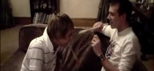 Execute the wooden spoon head hitting prank