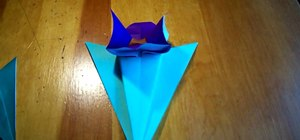 Fold an origami flower with stem and leaves