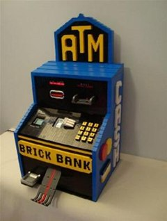 Ca-Ching. LEGO Brick Bank Dispenses Real Cash