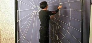 Craft a person-sized spiderweb out of rope