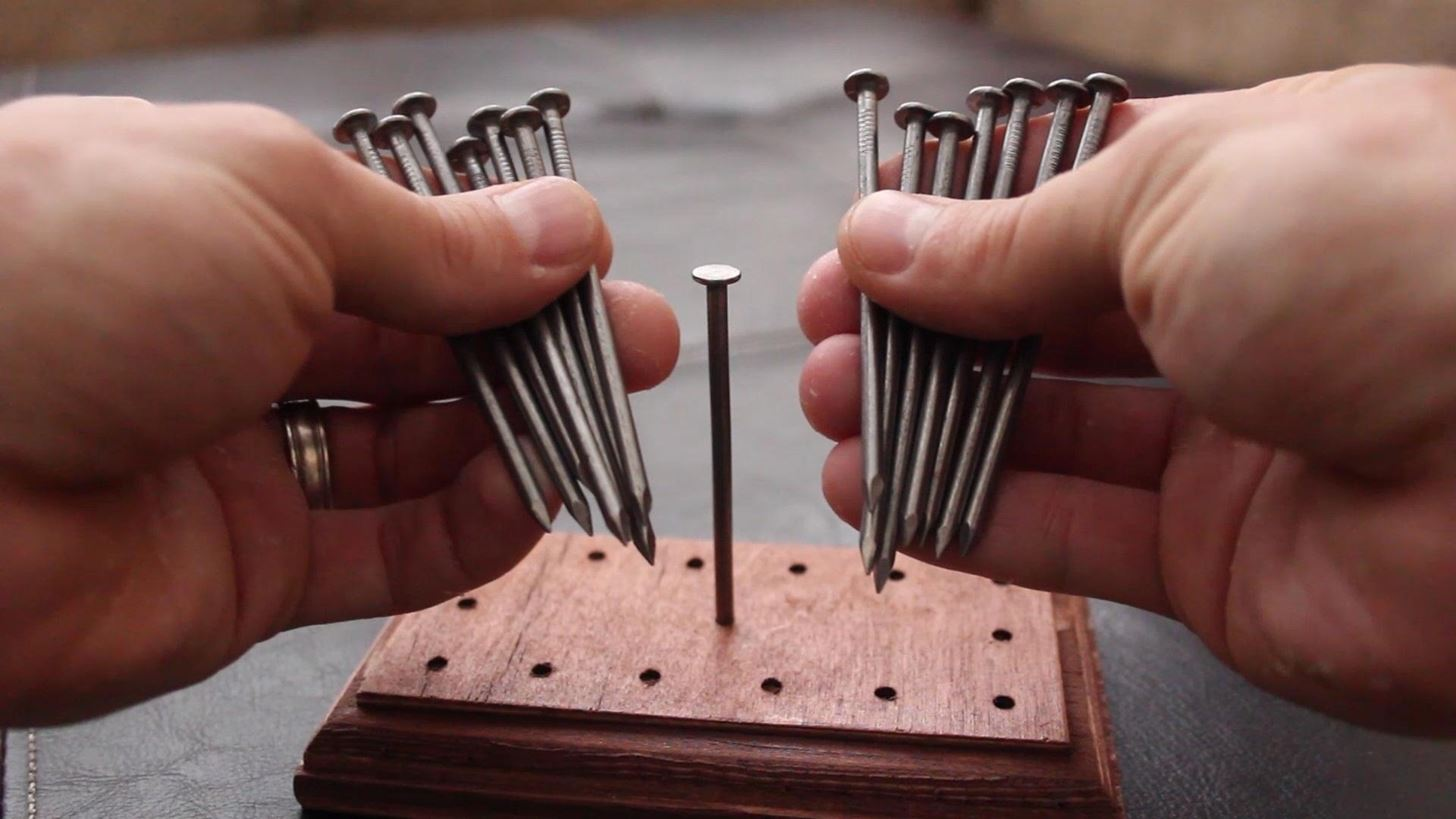How Do You Balance 14 Nails on a Single Nailhead? Find Out with This ...