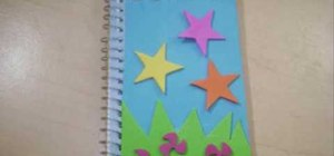 Decorate a spiral notebook with your children