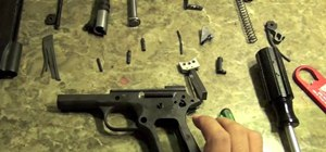 Disassemble a Rock Island 1911 handgun for maintenance, repair, or cleaning