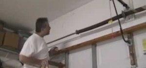 Replace your garage door torsion spring