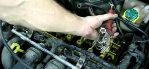 Repair a damaged spark plug tube
