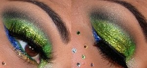 Create an emerald green and blue glittery holiday eye makeup look