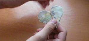 Fold a paper heart from a dollar bill with origami