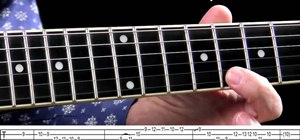 Play a swinging jazz blues lick on the guitar
