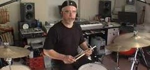 "Play ""Back in Black"" by ACDC on the drums"