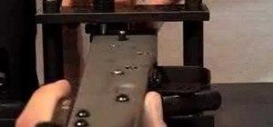 Press the rear trunnion rivets on an AK rifle