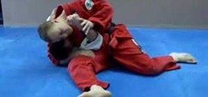 Do a Jiu Jitsu shoulder lock from a scarf hold