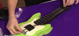 Make an electric guitar shaped birthday cake