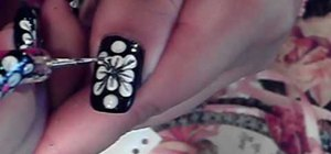 Paint short nails with a white flower art design