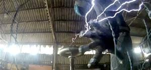 Man Shoots Lightning from Hands (Wearing Faraday Suit)