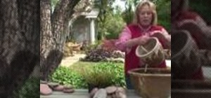 Make a simple garden fountain with flower pots and cobble stones