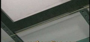 Install embossed acoustic ceiling tiles